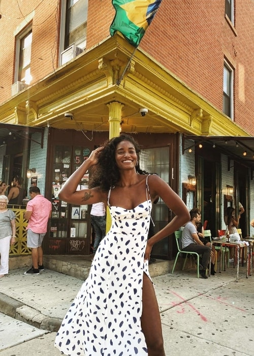 Melodie Monrose as seen while smiling for a picture at Miss Favela in Brooklyn, New York, United States in August 2019