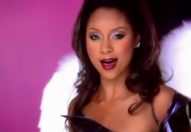 Natina Reed in a still from the music video of the song Bring It All to Me in 1999