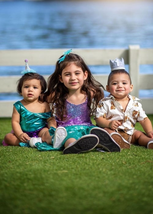 Penelope Juliette with her twin brother and sister