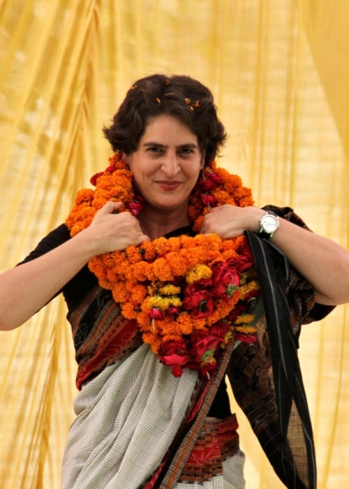 Priyanka Gandhi as seen in a picture taken while she was adjusting her flower garland during a election meeting in Raebareli on January 23, 2019