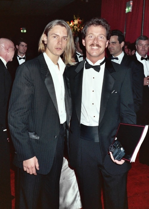 River Phoenix (Left) as seen while posing for the camera along with a fan at the 61st Academy Awards, March 29, 1989 - Governor's Ball