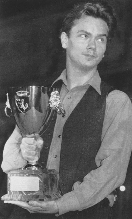 River Phoenix as seen while holding the Volpi Cup that he won for 'Best Male Performance' for 'Belli e damnati' (My Own Private Idaho) at the 48th International Film Festival of Venice in September 1991