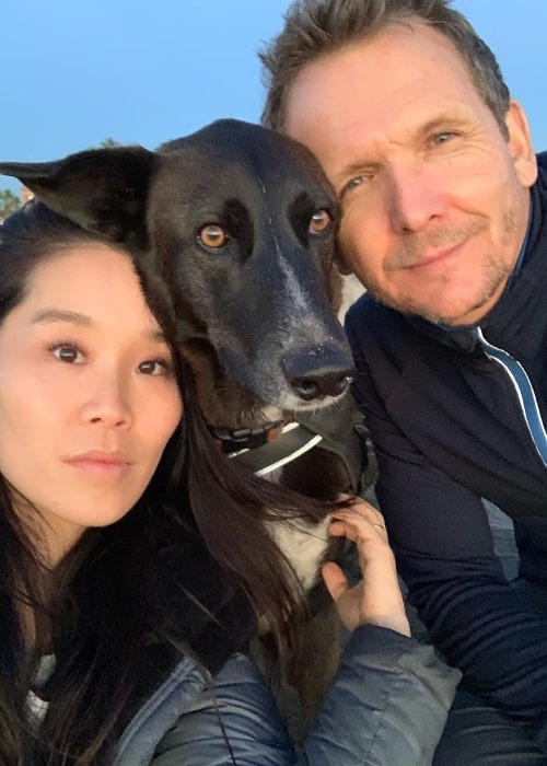 Sebastian Roché as seen while posing for a selfie along with Alicia Hannah and their dog in December 2018