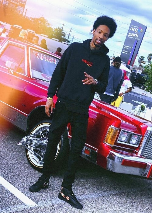 Sonny Digital as seen while posing for the camera showing his shoes in Houston, Texas, United States in November 2018