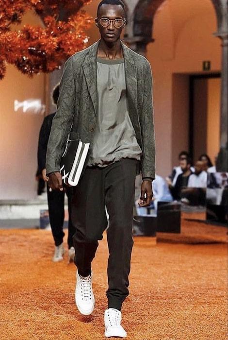 Yannick Bandora walking during Milan Fashion Show for Ermenegildo Zegna in 2017