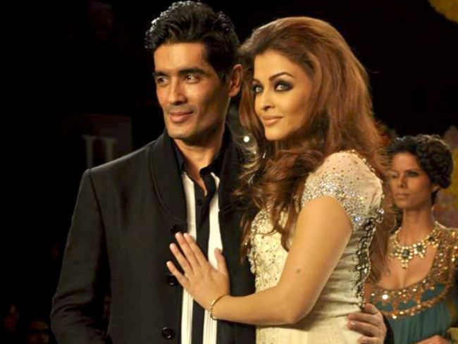 Aishwarya Rai posing with Manish after walking for the designer at the HDIL India Couture Week 2010