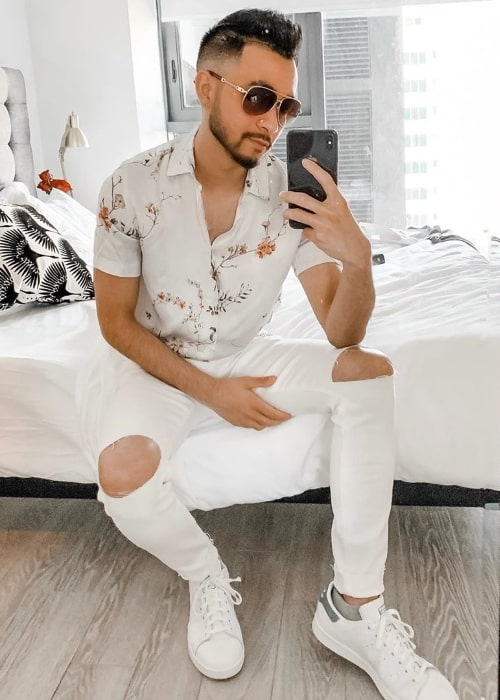 Alex Moy as seen while taking a mirror selfie in August 2019