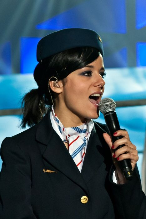 Alizée dressed up as a flight attendant and singing at the charity concert Le Bal des Enfoirés in 2012
