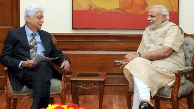 Azim Premji (Left) and Narendra Modi as seen in October 2014