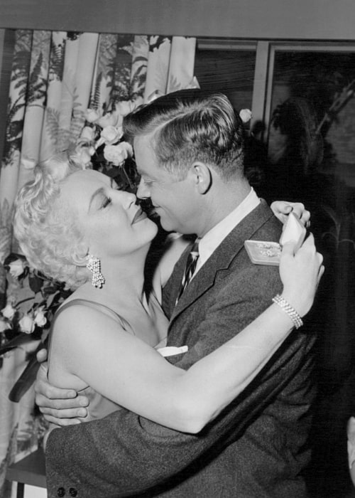 Betty Grable as seen along with Casey Adams in a black-and-white picture from the Star Stage presentation of 'Cleopatra Collins'
