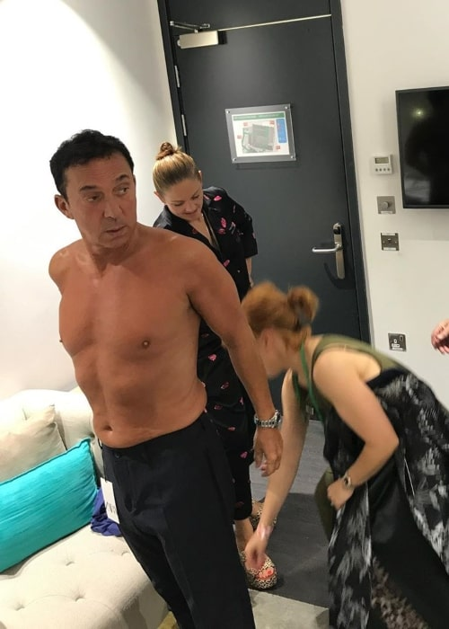 Bruno Tonioli as seen in a shirtless picture taken behind the scenes while getting ready on the set of Strictly Come Dancing in November 2019