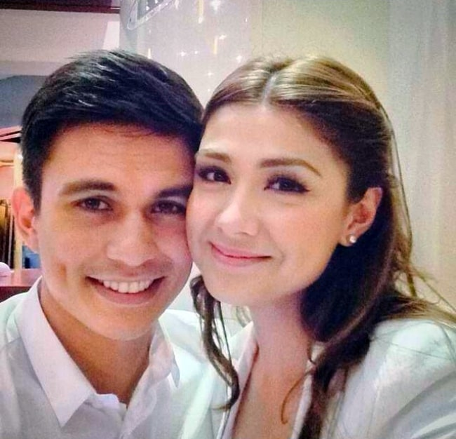 Carla Abellana as seen while smiling for a picture alongside Tom Rodriguez