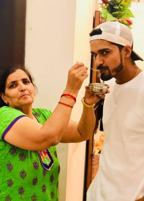 Deepak Hooda as seen in a picture taken with his mother in May 2018
