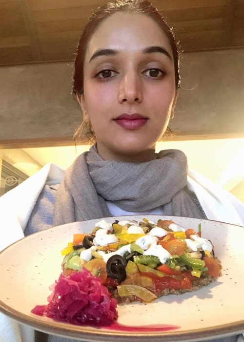 Ira Trivedi as seen in a picture taken while holding a healthy vegan meal in September 2019