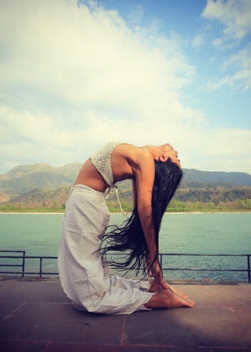 Ira Trivedi as seen in a picture taken while performing her yoga in a scenic background in December 2019