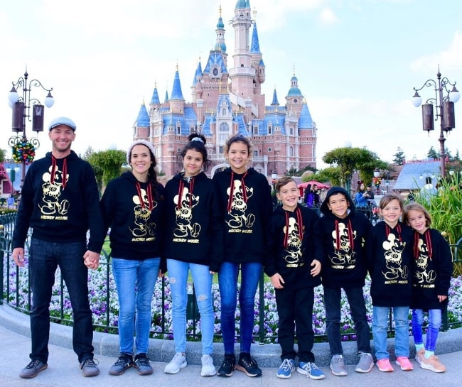 Jase Bennett as seen while posing for a picture alongside his family at Shanghai Disneyland Park located in Pudong, Shanghai, China in November 2019