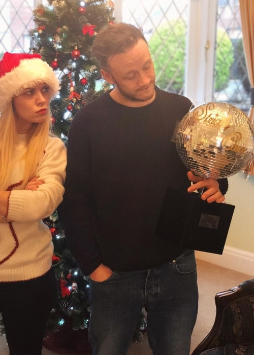 Joanne Clifton as seen in a picture with her brother Kevin Clifton while holding the Strictly Come Dancing series trophy in December 2018