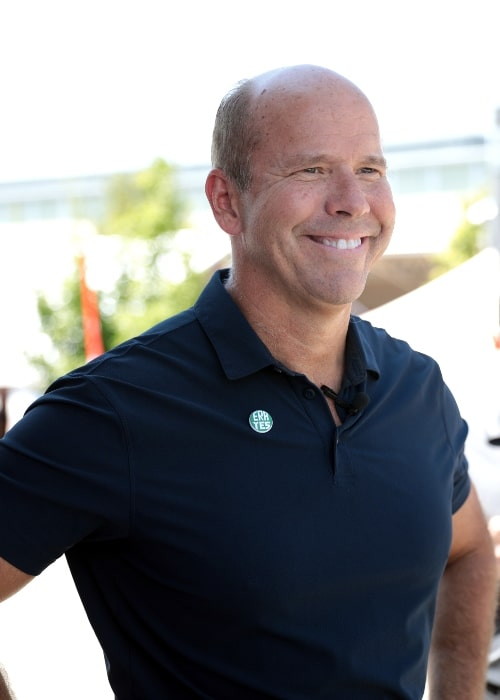 John Delaney smiling while speaking with supporters at the Des Moines Register's Political Soapbox at the 2019 Iowa State Fair in Des Moines, Iowa, United States