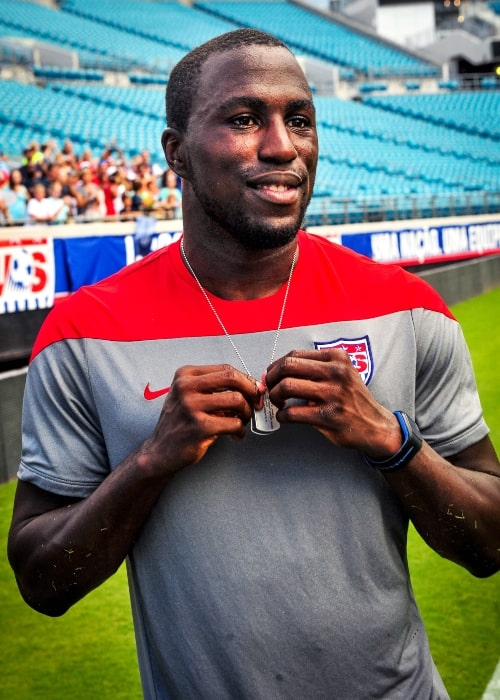 Jozy Altidore as seen in a picture taken while holding a custom 2014 World Cup dog tag that was presented to him at during an open-practice for fans at Everbank Stadium in June 2014