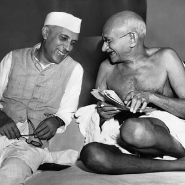 Mahatma Gandhi in a picture taken with Jawaharlal Nehru while they joke during a meeting of the All India Congress in Mumbai on July 6, 1946