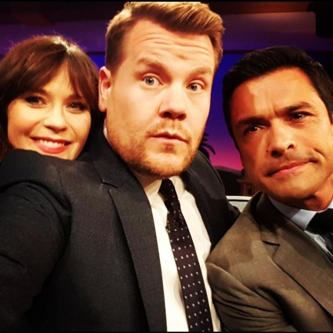 Mark Consuelos and Zooey Deschanel taking a selfie with James Corden on his talk show in November 2016