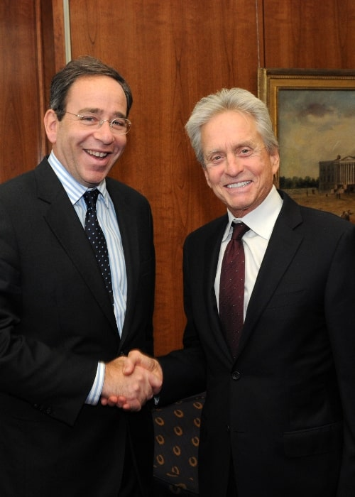 Michael Douglas (Right) as seen while shaking hands with Deputy Secretary of State Thomas Nides during his visit to the U.S. Department of State in Washington, D.C., on November 3, 2011