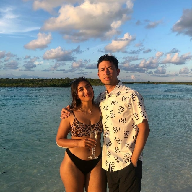 Noel Miller as seen while posing for a picture with a stunning backdrop alongside Aleena in The Bahamas in July 2019