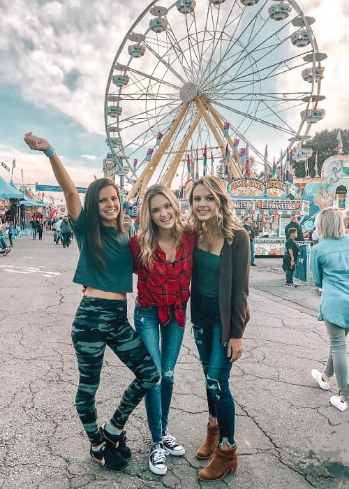 Paige Mackenzie as seen while posing for a picture alongside her friends, Marty Tucker (Left) and Ruth Tucker (Right), at Arkansas State Fair in Little Rock, Arkansas in October 2019