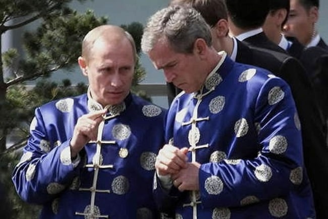 President Vladimir Putin (Left) with US President George W. Bush in Shanghai at APEC Summit in China in October 2001
