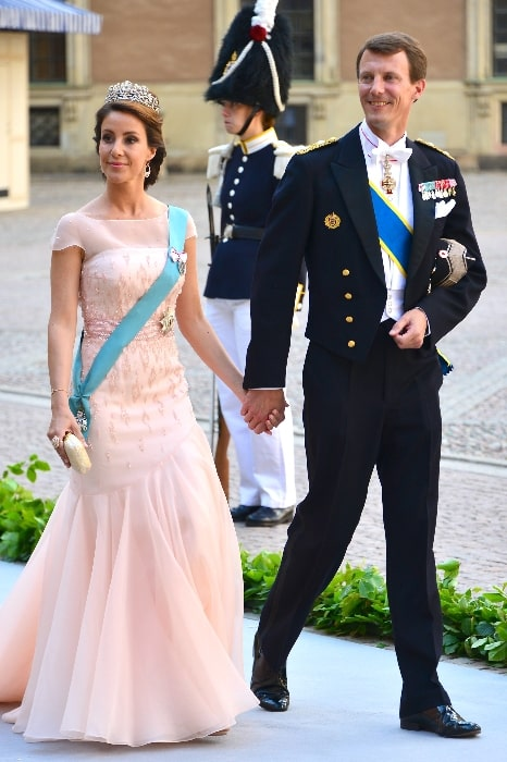 Prince Joachim of Denmark and Princess Marie of Denmark on the way to the castle church at the Royal Palace in Stockholm for the wedding of Princess Madeleine and Christopher O'Neill on June 8, 2013