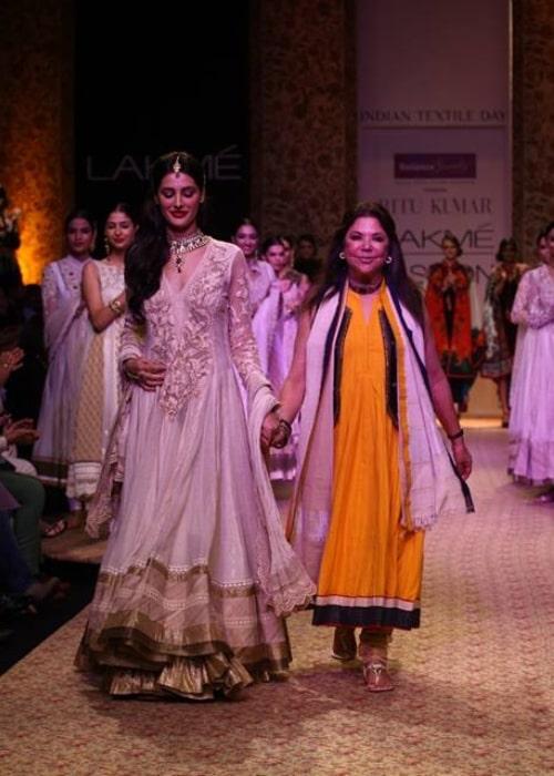 Ritu Kumar as seen in a picture walking the ramp alongside actress and model Nargis Fakhri at the Lakme Fashion Week at Grand Hyatt Mumbai on August 26, 2013