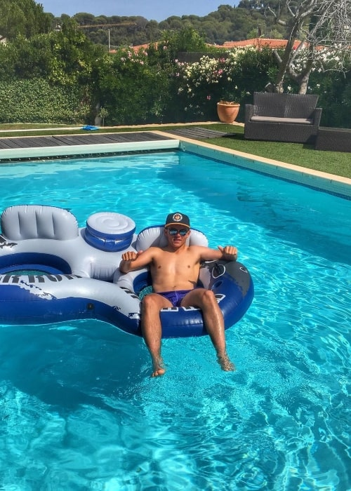 Sam Curran as seen in a shirtless picture taken while relaxing in the pool in Juan-les-Pins, France in August 2016