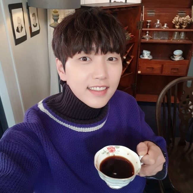 Sandeul as seen while taking a selfie in January 2019