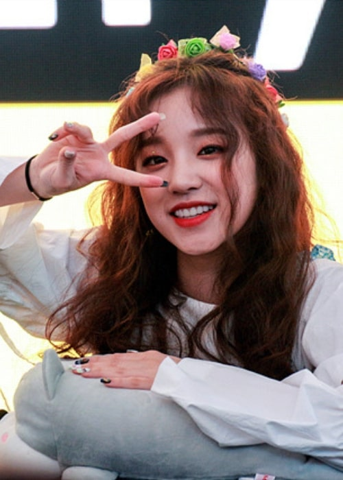 Song Yuqi as seen while smiling and posing for a picture during an event in June 2018
