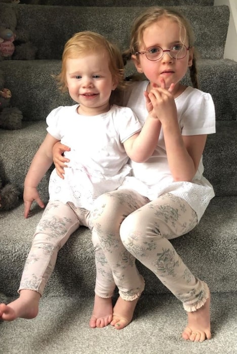 Sophie Conder as seen while sitting alongside her younger sister, Chloe, in May 2019
