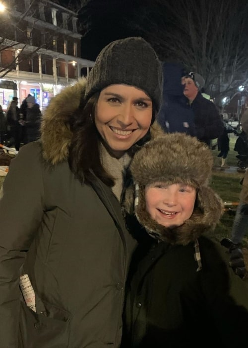 Tulsi Gabbard as seen in a picture taken while she poses in a picture with a child at the Nashua's Winter Holiday Stroll in Southern New Hampshire in December 2019