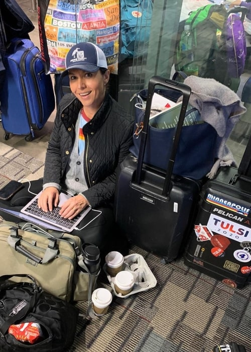 Tulsi Gabbard as seen in a picture while she sits on the floor of the Minneapolis-Saint Paul International Airport while waiting for a second flight to New Hampshire in November 2019