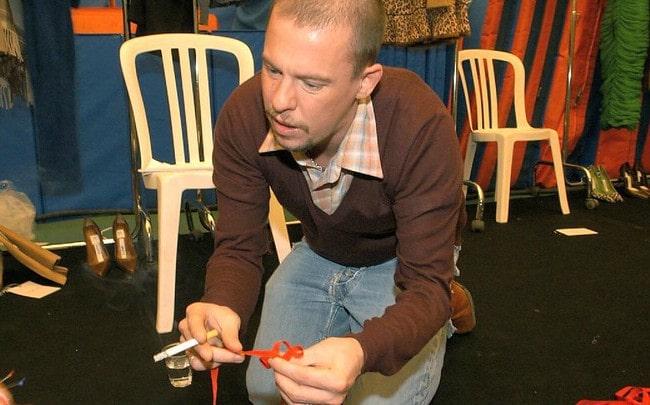 Alexander McQueen prepararing for a fashion show