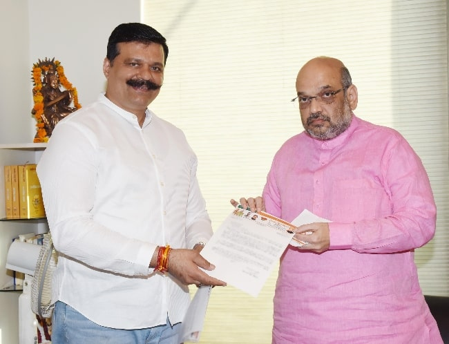 Amit Shah (Right) as seen while posing for the camera along with politician Kunwar Pranav Singh in September 2017
