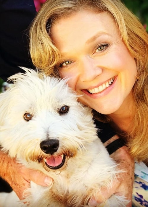Ariana Richards as seen in a closeup picture taken with her dog Laddie in August 2019