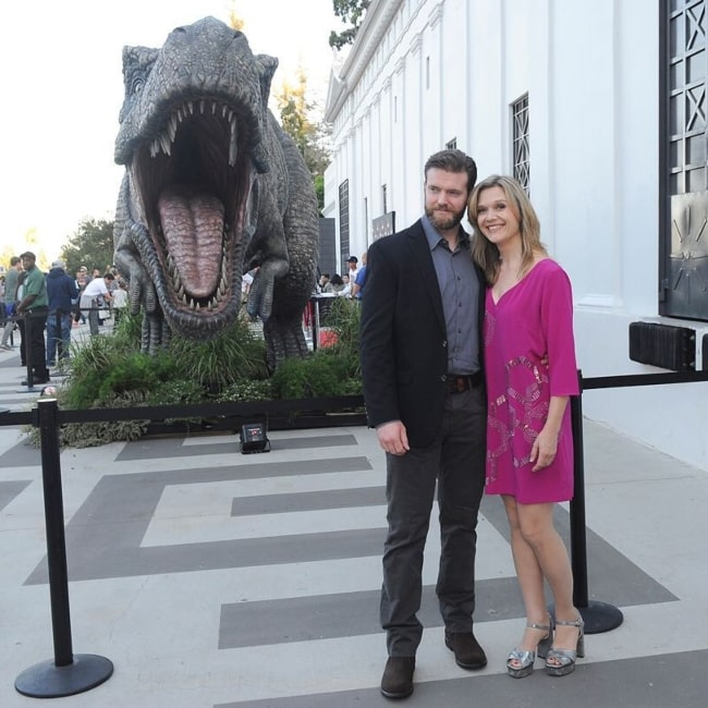 Ariana Richards as seen in a picture taken with her husband Mark Aaron Bolton in front of a large T-Rex from the film Jurassic Park in Los Angeles, California in June 2018