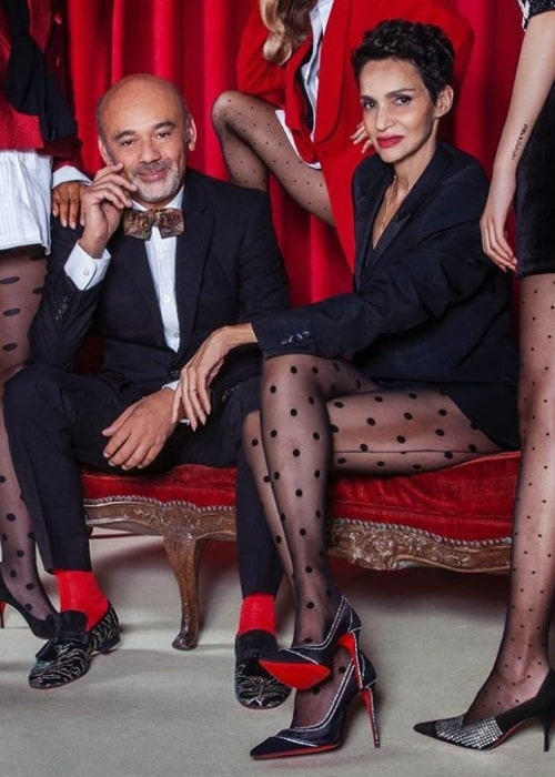 Christian Louboutin as seen while posing for the camera along with Farida Khelfa-Seydoux in October 2019