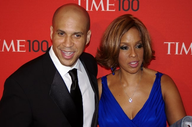 Cory Booker as seen while posing for the camera along with Gayle King at the 2011 'Time 100' gala in April 2011
