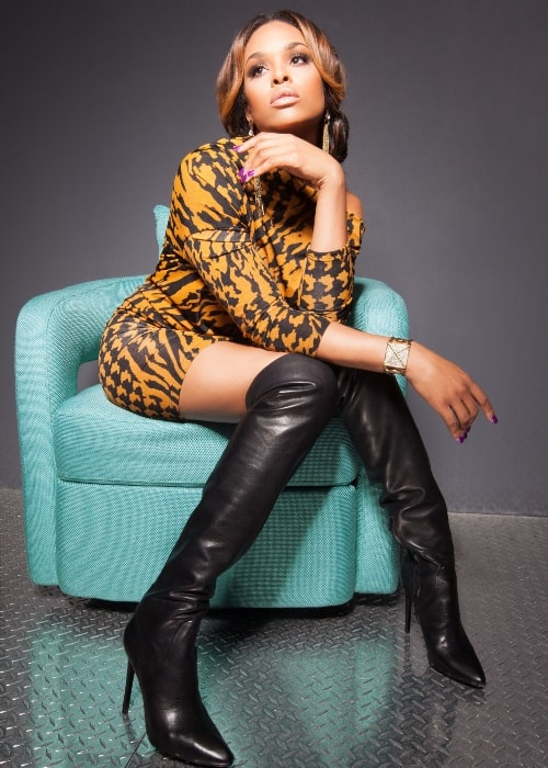 Demetria McKinney as seen in a picture taken in Jimmy Choo Over The Knee Boots at the L'ACIREMA Promo in 2012