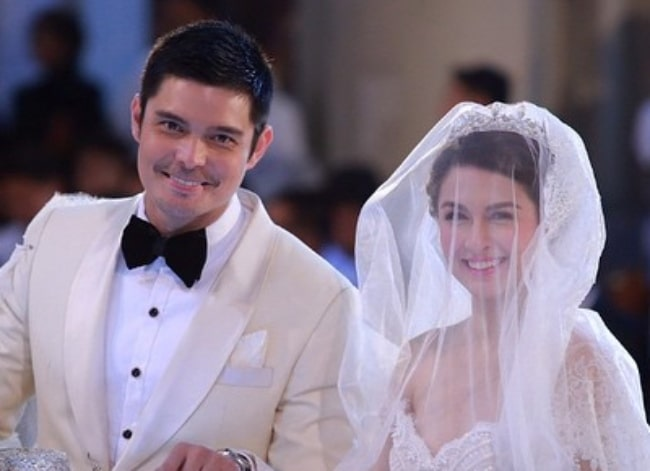 Dingdong Dantes as seen while smiling in his wedding picture alongside Marian Rivera