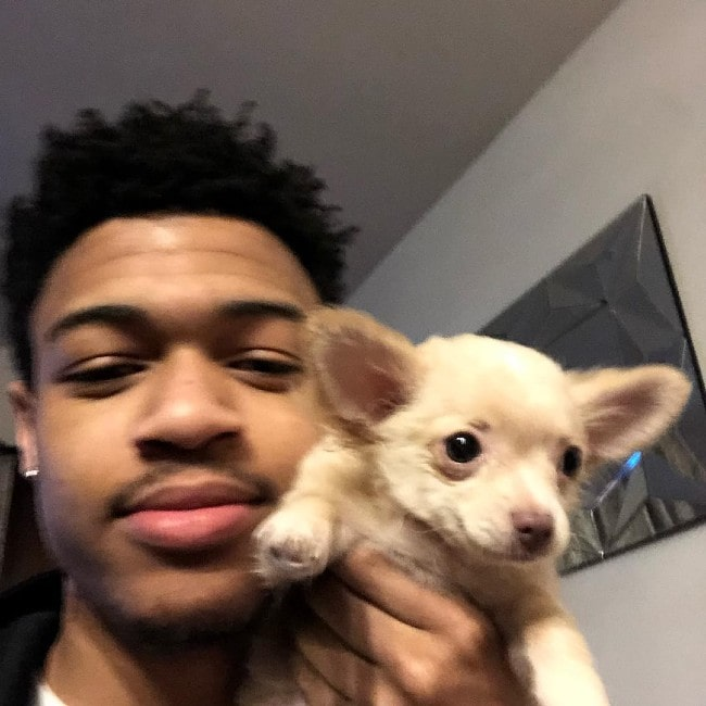 DopeIsland with his dog as seen in February 2019