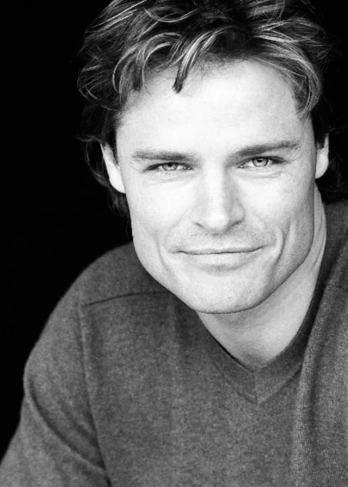 Dylan Neal as seen in a black-and-white publicity shot