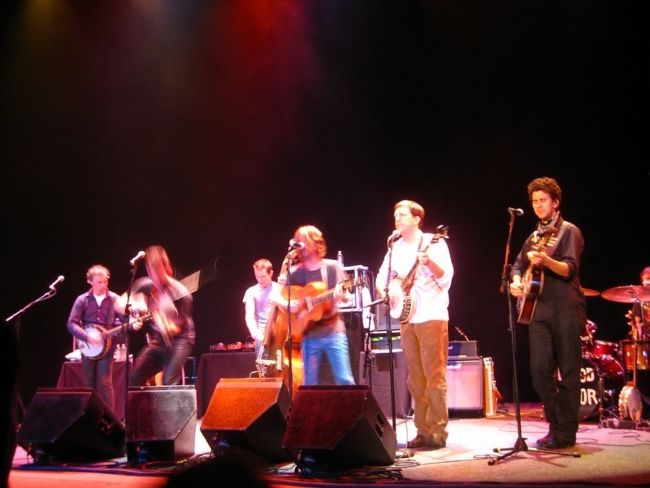 Ed performing onstage with Old Crow Medicine Show in Michigan in 2009