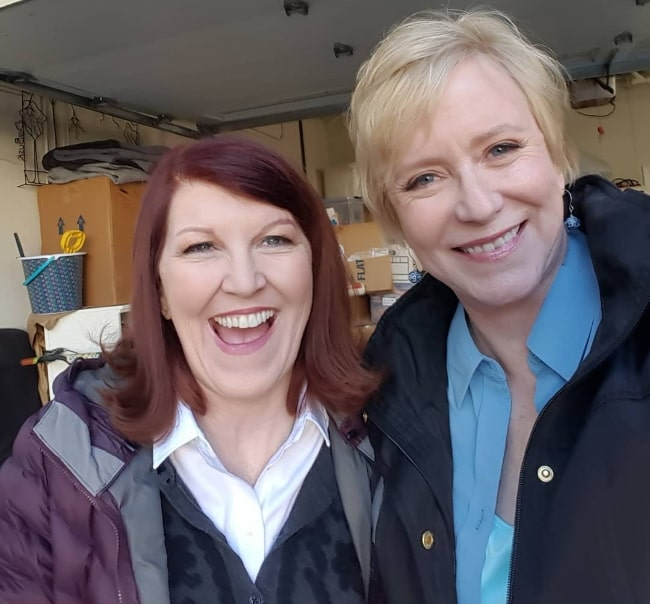 Eve Plumb (Right) as seen while smiling in a picture alongside Kate Flannery on the sets of 'A Very Brady Renovation' in January 2019