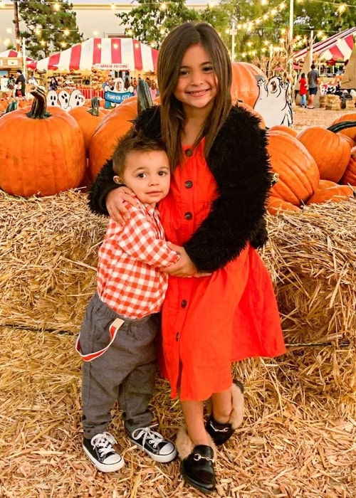 Jayden Foley as seen while posing for the camera alongside his sister during their time in a pumpkin patch in October 2019